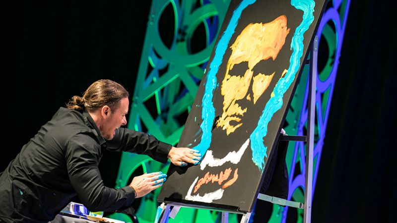 Artist Erik Wahl painting at NAILBA 2016