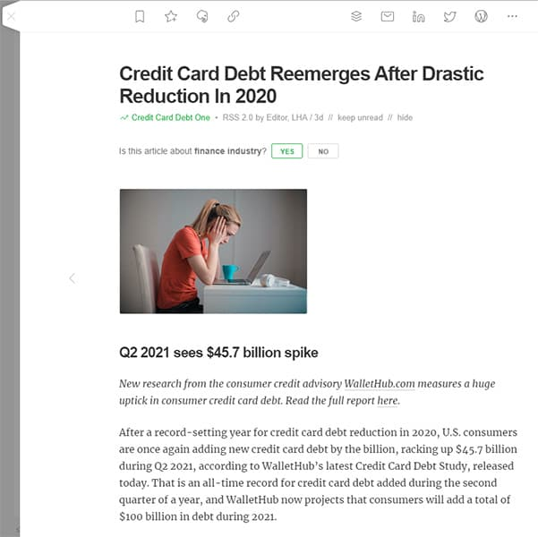 Screenshot of an article about increasing credit card debt visible in the Feedly reader