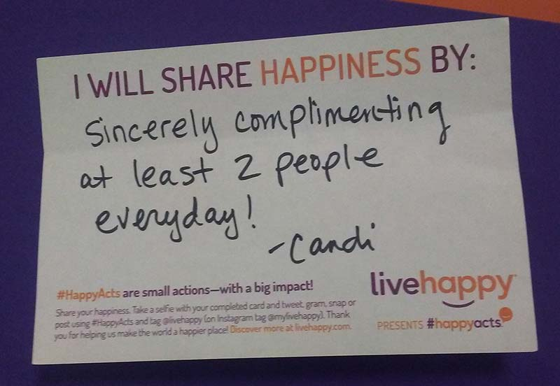 A picture of Candi's note explaining how she will share happiness. It says: I will share happiness by sincerely complimenting at least 2 people everyday!