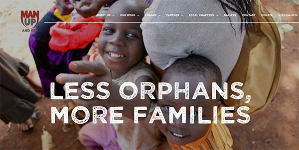 Screenshot of the Man Up and Go website, showing a crowd of smiling African children
