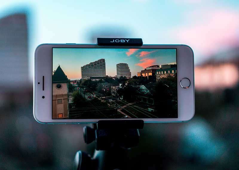 Screenshot of an iPhone and tripod set up to do an easy cell phone video.